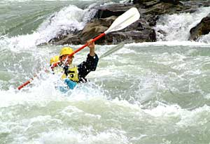 Kayaker in Whitewater of Clearwater River, BC
